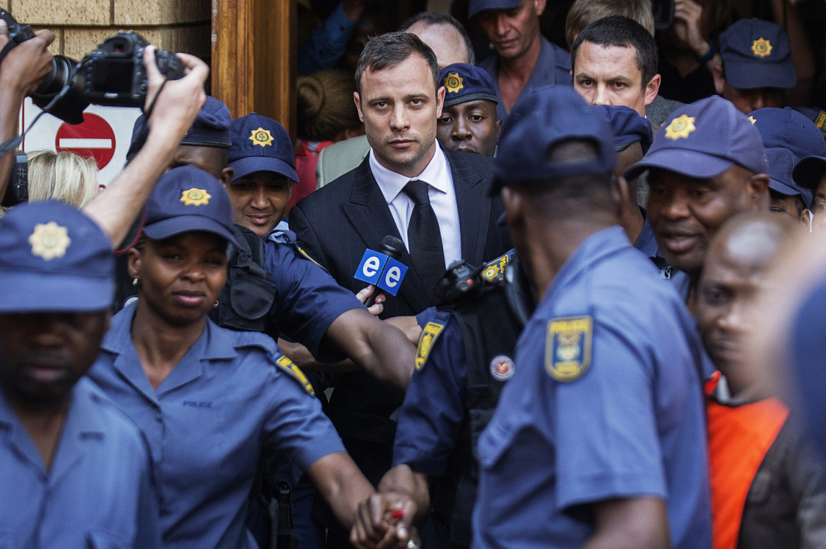 South African Paralympian athlete Oscar Pistorius leaves the High Court after the verdict in his murder trial where he was found guilty of culpable homicide in Pretoria, South Africa on Sept. 12, 2014.Image from here.
